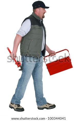 A manual worker with a toolbox. - stock photo