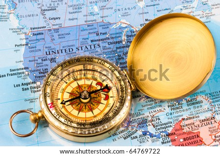 A map of the USA with a compass laid over it - stock photo