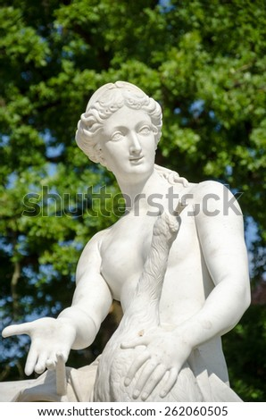 A marble statue, from around 1750, located at Sanssouci summer palace of Frederick the Great, King of Prussia, in Potsdam, near Berlin. - stock photo