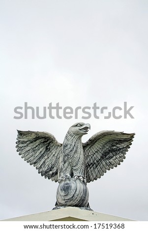 A Marble Statue of an eagle with wings spread - stock photo