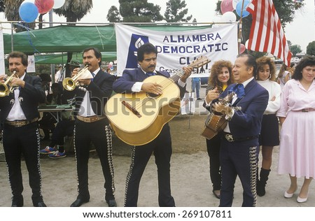 A mariachi band performs for the 1992 Democratic campaign, East Los Angeles, CA - stock photo