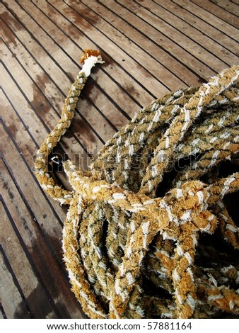 a marine rope on the wood floor - stock photo