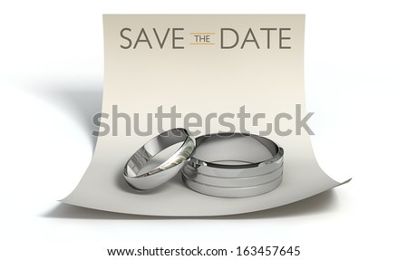 A marriage or engagement concept showing a man and woman silver wedding bands on a curled paper note with a heading saying save the date on an isolated white background - stock photo