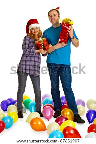 A married couple with Christmas gifts isolated on white background - stock photo