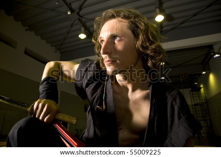a martial artist samurai warrior poised and ready for action - stock photo