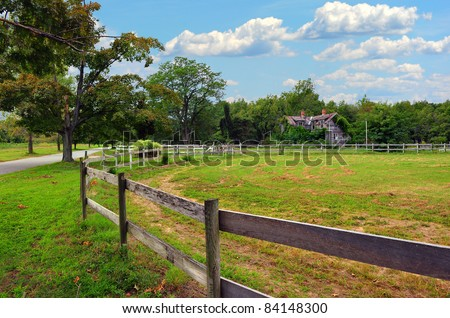 A Maryland rural farm and stable with a country road and old rustic farm house - stock photo