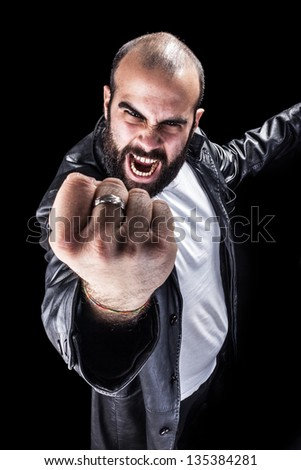 a masculine bearded man isolated over a black background - stock photo