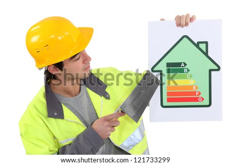 A mason promoting energy savings. - stock photo