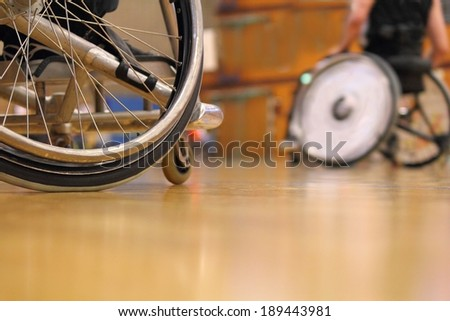 A match in a gym with Wheelchair Sport - stock photo