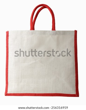 A material bag with red handle isolated on a white background, side view blank copy space - stock photo
