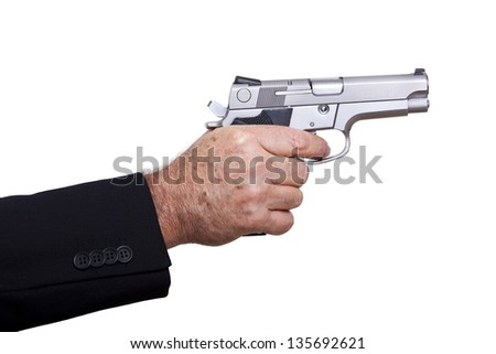 A mature adult man wearing a suit, holding a 9mm gun with his right hand, aiming it to the target. Isolated on white background. - stock photo