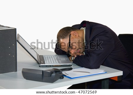 a mature African-American businessman having a power nap in his office, isolated on white background - stock photo