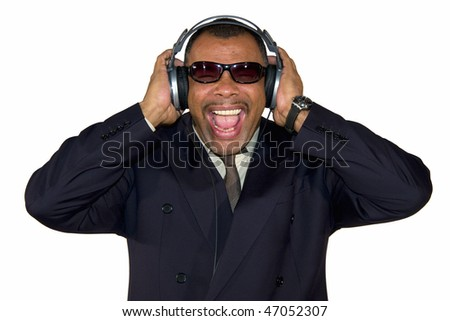 a mature African-American man with sunglasses and headphones listening to loud music and screaming, isolated on white background - stock photo