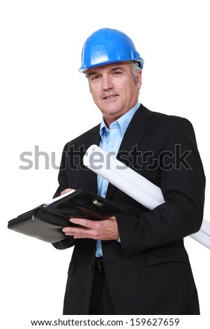 A mature architect with a planner. - stock photo