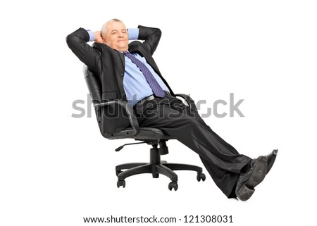 A mature businessman resting in armchair isolated on white background