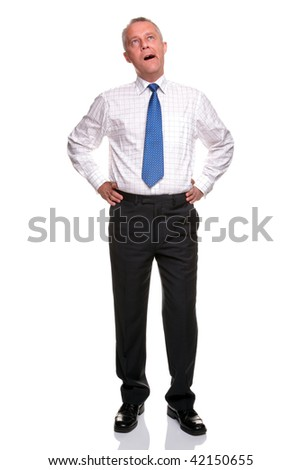 A mature businessman with his hands on his hips yawning, isolated on a white background. - stock photo
