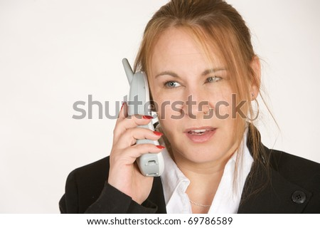 A mature businesswoman talking on wireless phone - stock photo