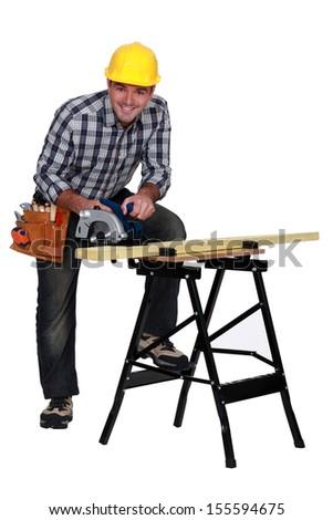 A mature carpenter - stock photo