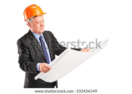 A mature construction worker with helmet holding blueprint isolated against white background - stock photo