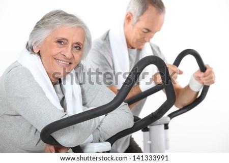 A mature couple exercising. - stock photo