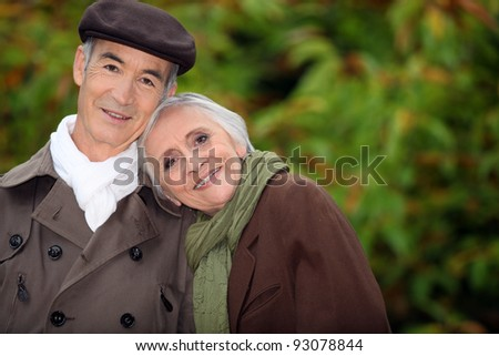 A mature couple in a park. - stock photo