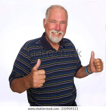 A mature man giving two thumbs up - stock photo