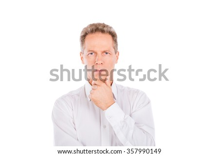 A mature man in a shirt with a hand on his chin - stock photo
