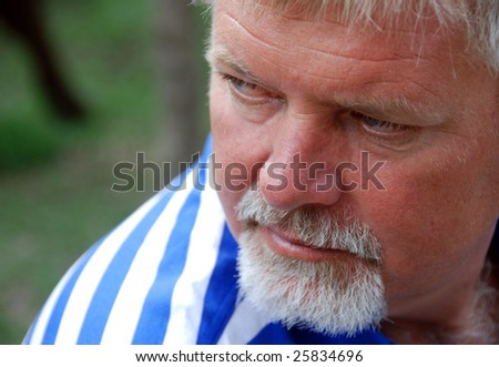 A mature man looking away over his shoulder - stock photo
