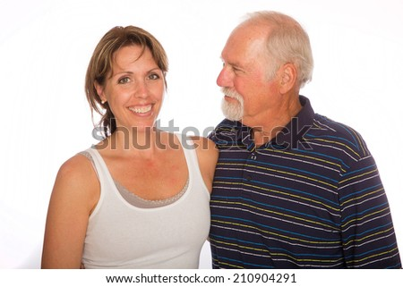 A mature man looks at his grown daughter with pride - stock photo