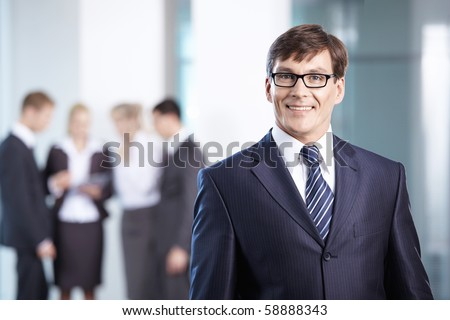 A mature man on a background of staff