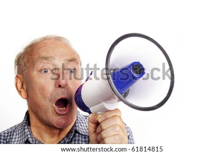 A mature man shouting through a bull horn isolated against white background. - stock photo