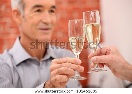 A mature man toasting. - stock photo