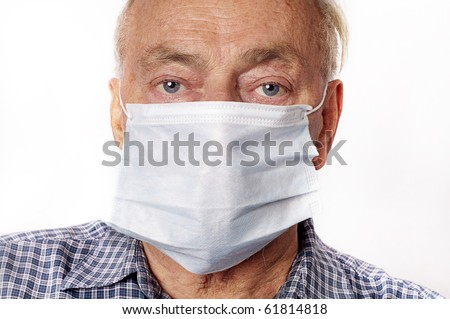 A mature man wearing a protective breath mask. - stock photo