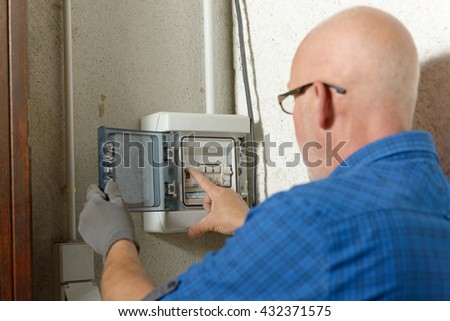 home fuse box stock images royalty images vectors a mature man working electric box at house