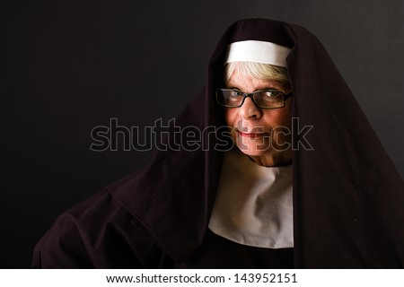 A mature nun with a friendly face - stock photo