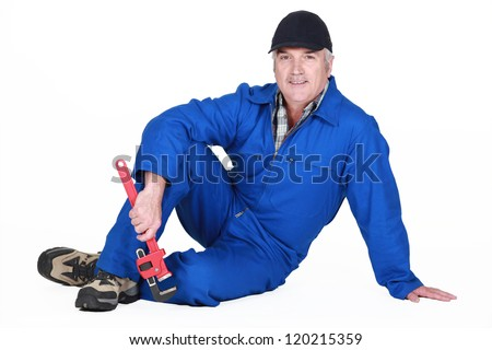 A mature plumber. - stock photo