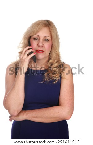 A mature woman talking on her cell phone. Isolated on white with room for your text - stock photo