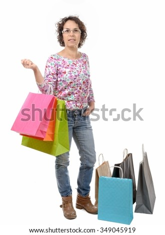 a mature woman with eyeglasses went shopping on white background - stock photo