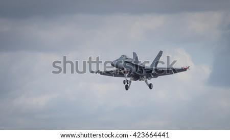 A McDonnell Douglas F/A-18 Hornet aircraft in flight - stock photo