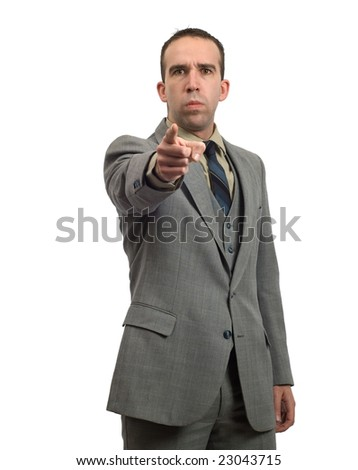 A mean businessman is pointing towards the front - stock photo