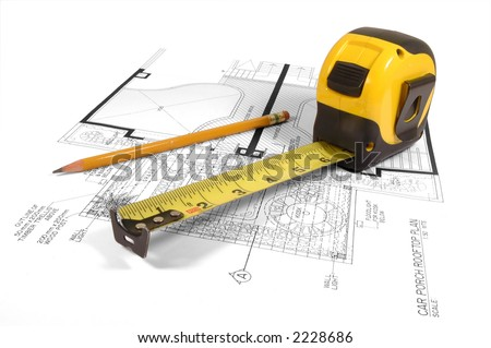 A measuring tape and a pencil over a construction drawing of a house (design and drawings by the submitter) - stock photo