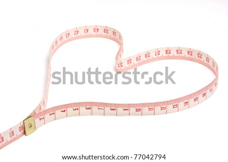 A measuring tape shaping a heart - stock photo
