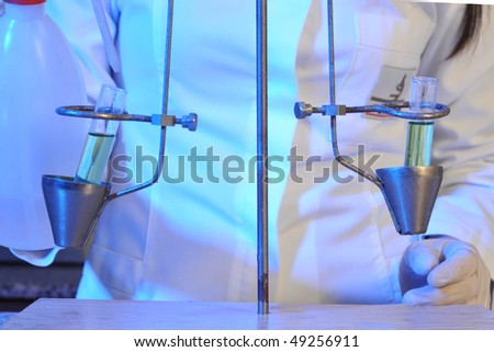 A medical assistant working on traditional measure equipment at pathology lab. A series of laboratory related pictures. - stock photo