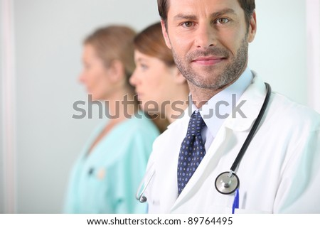 A medical doctor with his assistants - stock photo