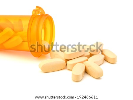 A medical pill bottle with a blank label for copy space and the bottle is isolated on a white background.  - stock photo