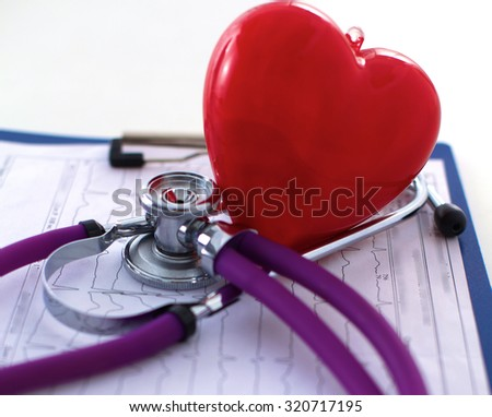 A medical stethoscope near on a  table, on white - stock photo