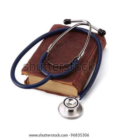 A medical stethoscope over a book