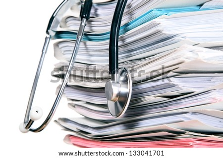 A medicine stethoscope is lying on bunch of paper - stock photo