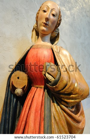 a medieval wooden depiction of Mother Mary on display at the cloisters in New York City. - stock photo