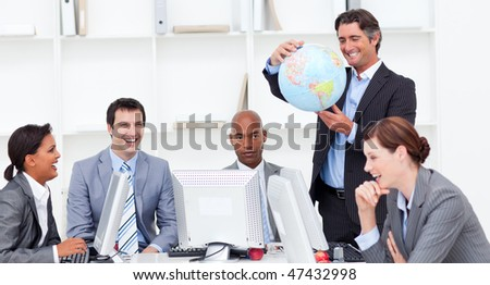 A meeting of a lucky business team about globalization in a company - stock photo